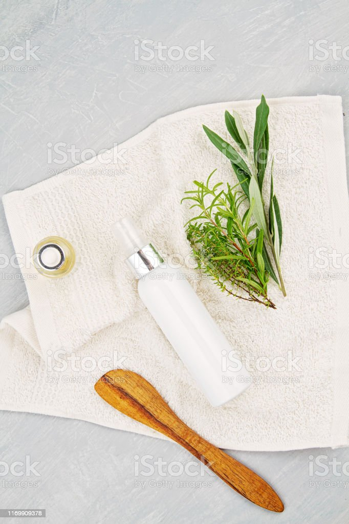 Spa and wellness composition with serum, towels and beauty products....