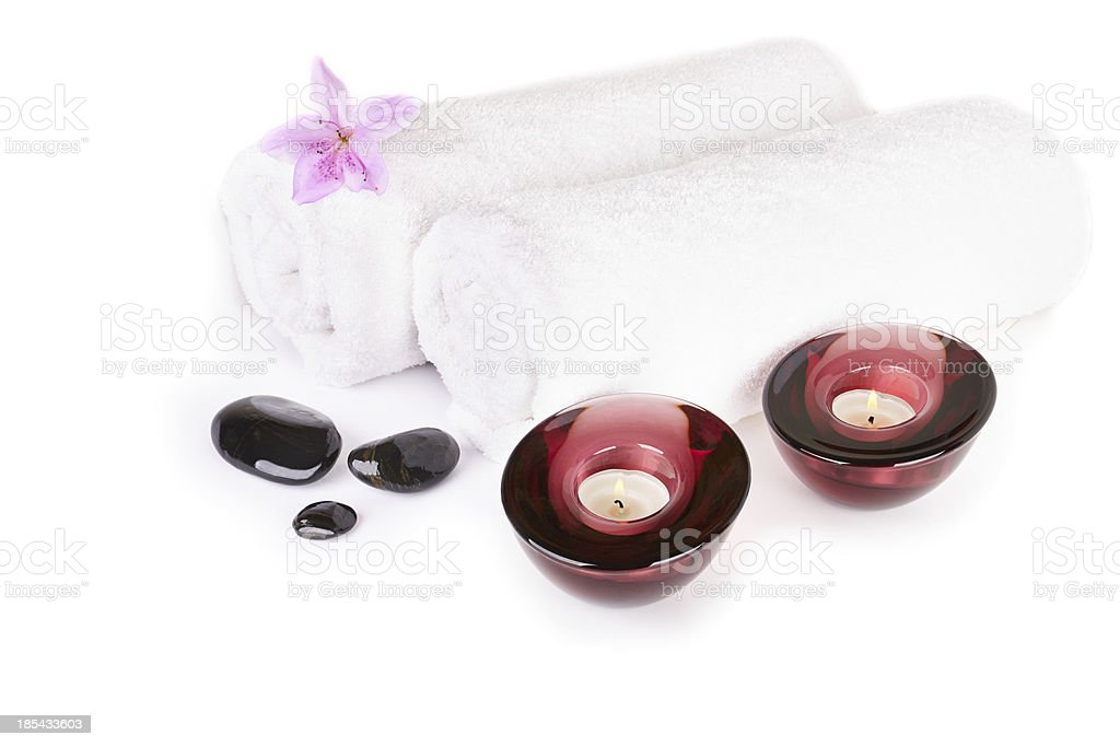 Spa and wellness setting with natural stones, candles, towel royalty-free stock photo