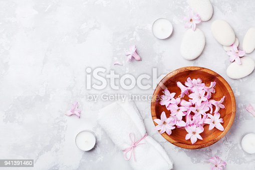 istock Spa, aromatherapy, beauty background with massage pebble, perfumed flowers water and candles. Relaxation and zen like concept. 941391460
