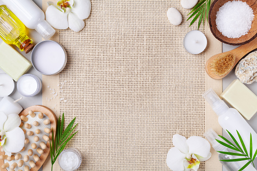 istock Spa, aromatherapy, beauty treatment and wellness background with massage brush, oil, orchid flowers and cosmetic products flat lay. 1133402486