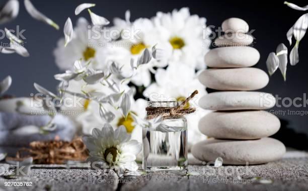Spa background chamomile essential oil with fallen leaves picture id927035762?b=1&k=6&m=927035762&s=612x612&h=xmf lilecfuqxg14jaecrvdzukwaqxiiuupqce6o5p8=