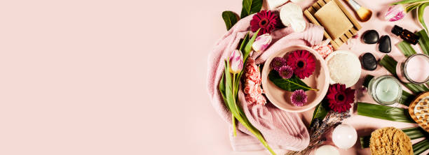 Spa background. Flat lay Spa background with sea salt, bowl ,flowers, water, soap bar, candles, essential oils, massage brush and flowers,top view. Flat lay. Pink background spa belgium stock pictures, royalty-free photos & images