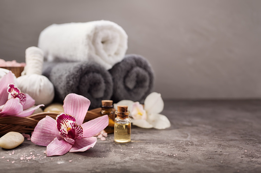 Spa background with orchid flower and massage oil on table. SPA background with copyspace