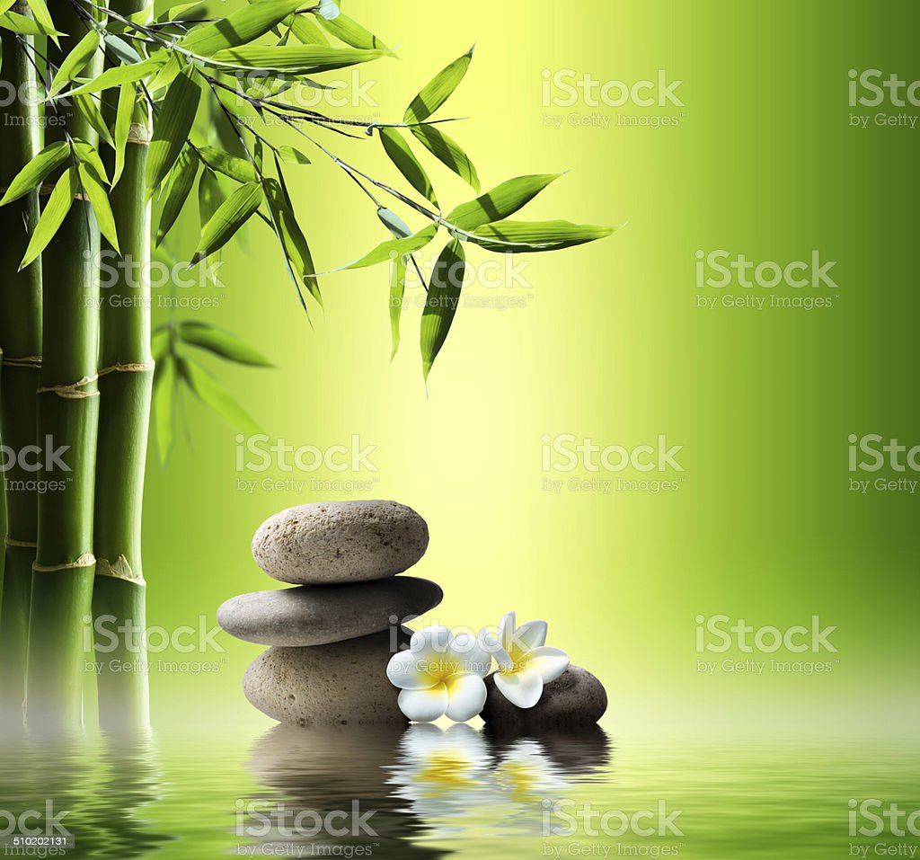 spa background with bamboo and stones on water stock photo