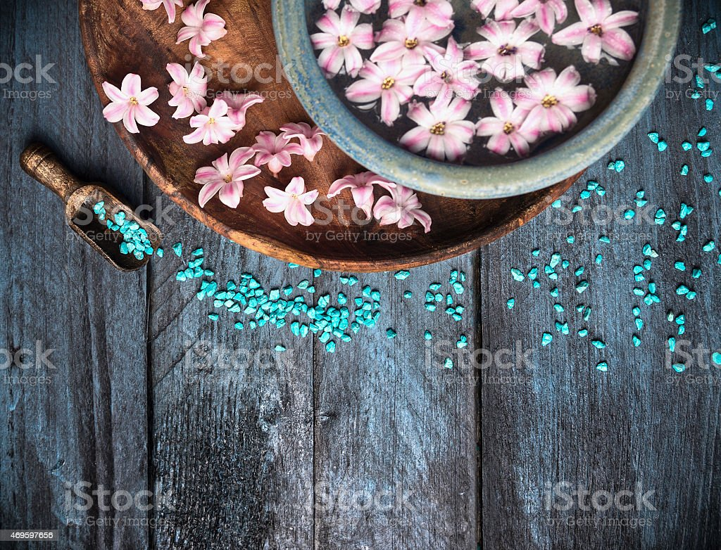 Spa background with sea salt, bowl ,flowers and water stock photo