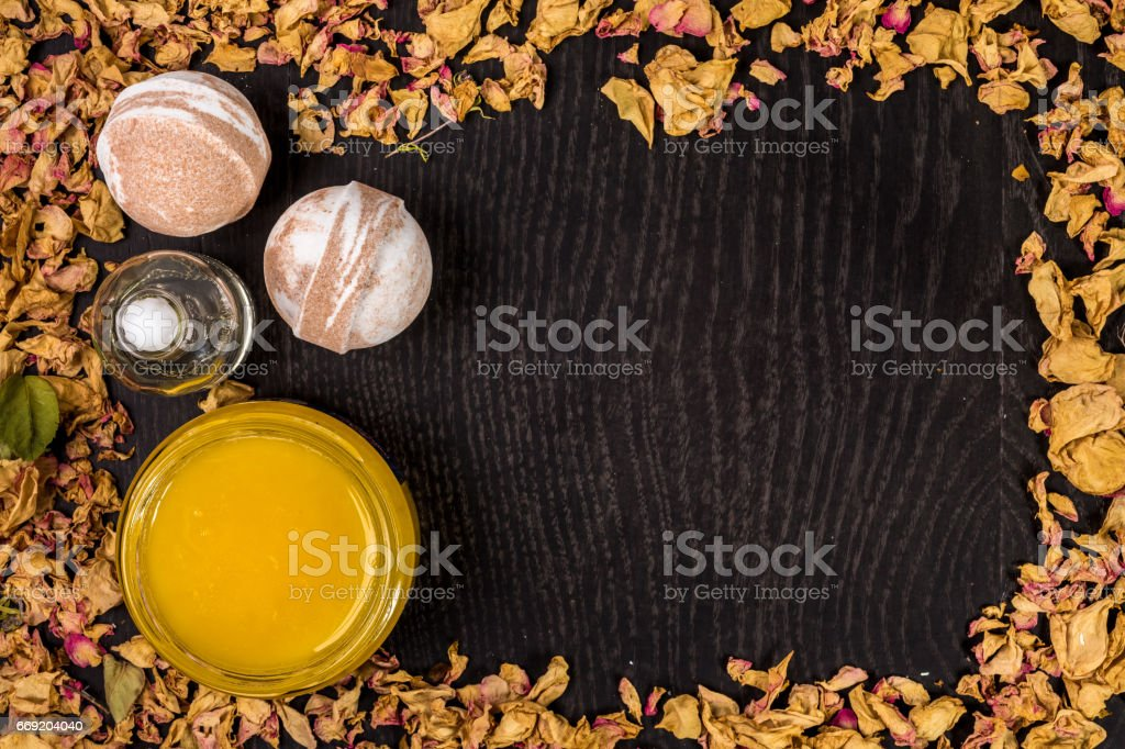 Spa bath cosmetic. Aromatherapy with natural honey and  bomb. Hygiene  relaxation for bo stock photo