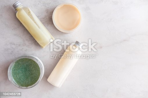 824824368 istock photo Spa beauty cosmetics on white marble 1042453728