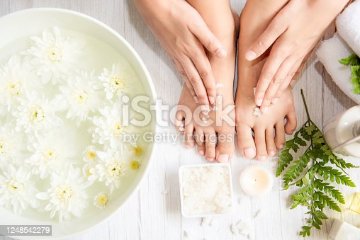 istock Spa beauty massage health wellness.  Spa Thai therapy treatment aromatherapy for foot and hands woman 1248542279