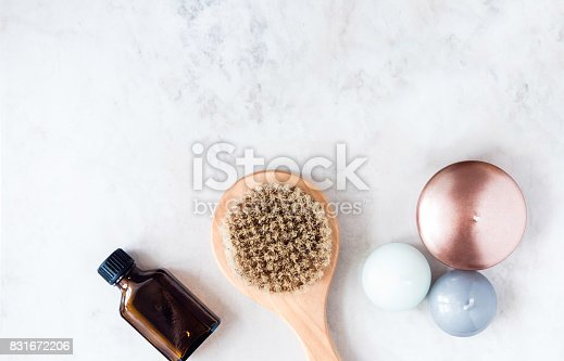 824824368 istock photo Spa beauty products on white marble table from above. Beauty blogger concept. Copyspace 831672206