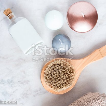 824824368 istock photo Spa beauty products on white marble table from above. Coconut oil, brush, candles, towel. Beauty blogger, massaging salon concept. 846342480