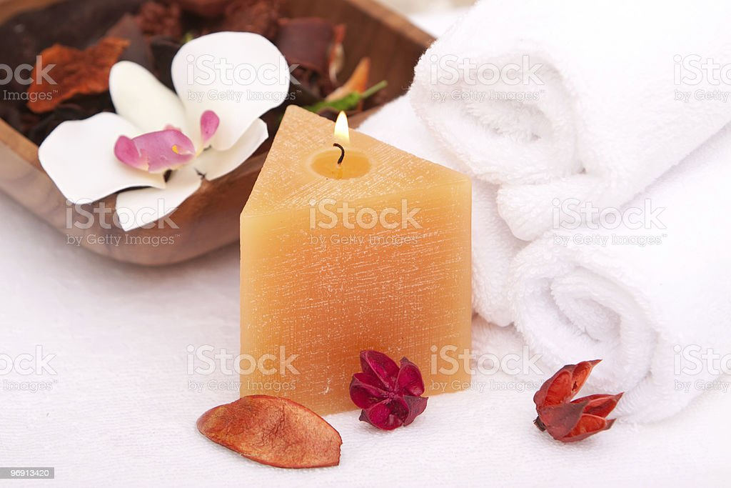 Spa candle and white towels royalty-free stock photo