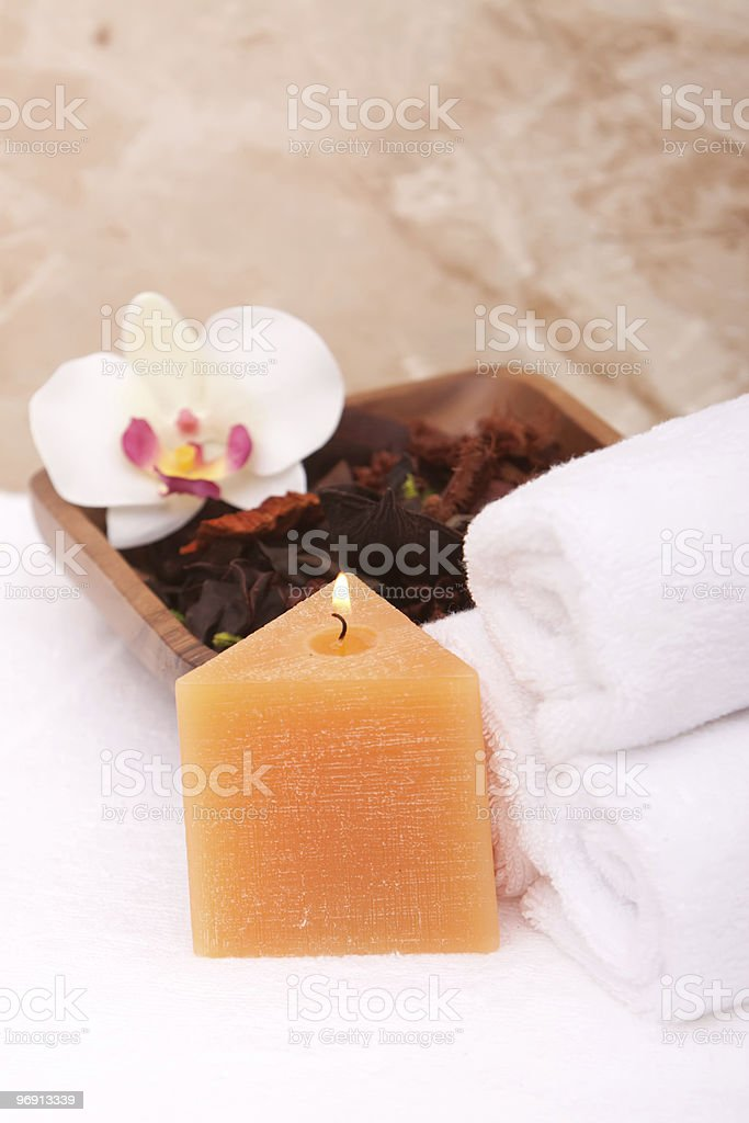 Spa candle, towels and orchid royalty-free stock photo