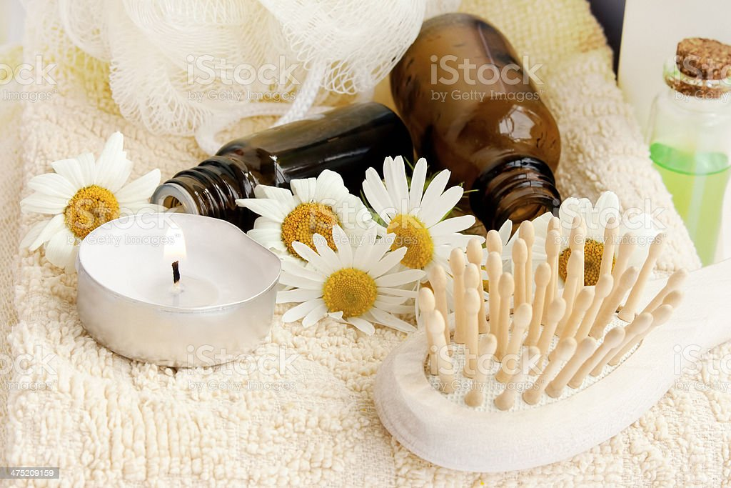 Spa candle with essence bottles royalty-free stock photo