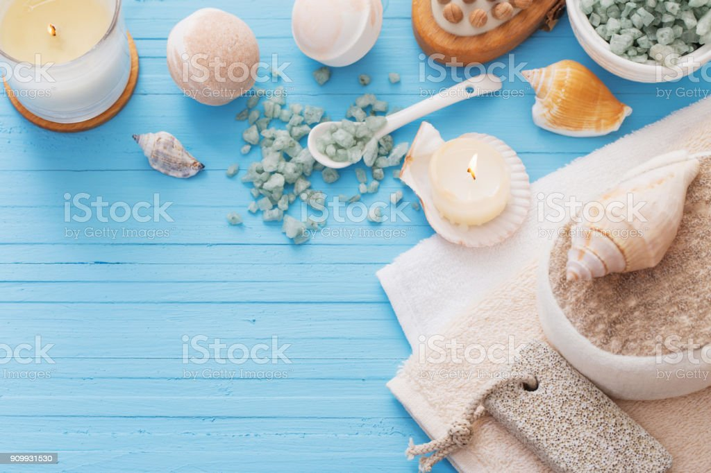 Spa concept with candles on blue wooden background stock photo