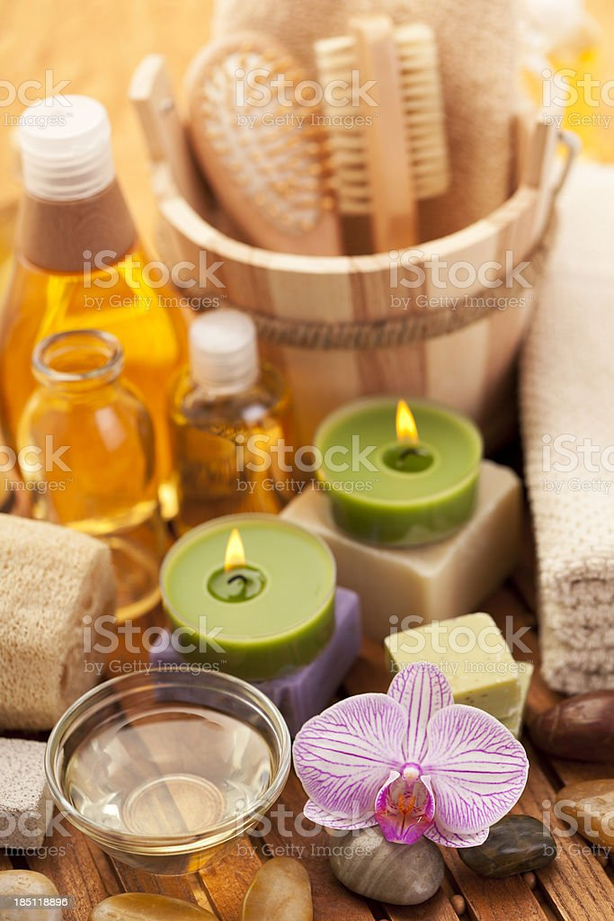 Spa concept with candles, towel, loofah royalty-free stock photo