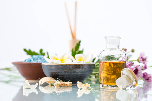 Spa concept with Floating Flowers, essential oil, and salt stock photo