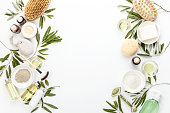 Spa concept with olive oil and olive leaf extract natural cosmetic ingredients, flat lay composition with blank space for a text
