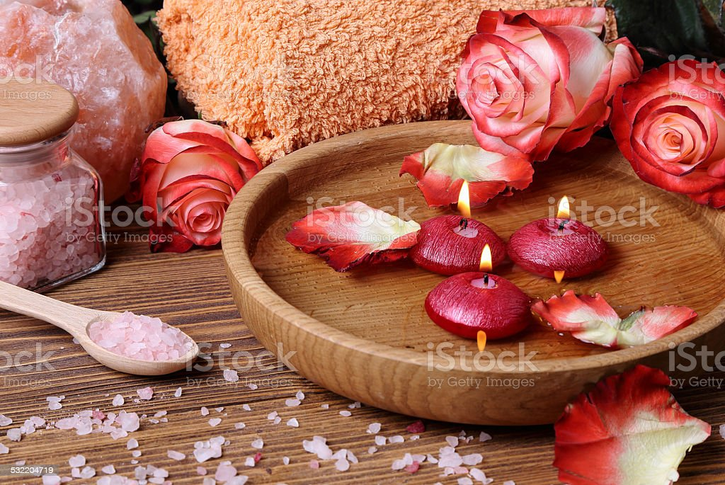 Spa concept with roses, pink salt and candles stock photo