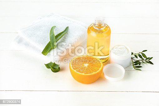 istock Spa concept with salt, mint, lotion, towel on white background 872900374