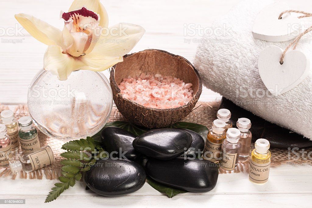 spa concept with stones, flowers , essential oils and mineral salt stock photo