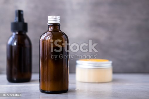 1042453716 istock photo Spa cosmetics in brown glass bottles 1077880340