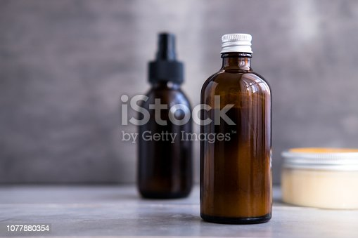 1042453716 istock photo Spa cosmetics in brown glass bottles 1077880354