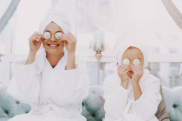 Spa Day for Smiling Happy People in Beauty Salon. stock photo