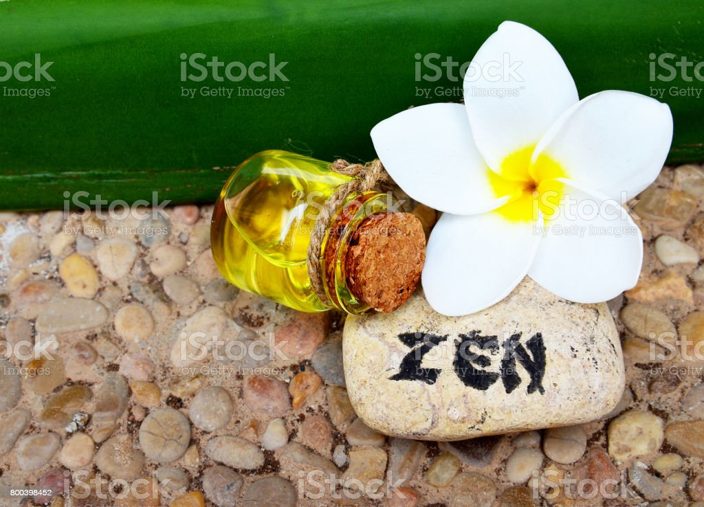 Spa decoration with massage oil,frangipani flower and zen stone. stock photo