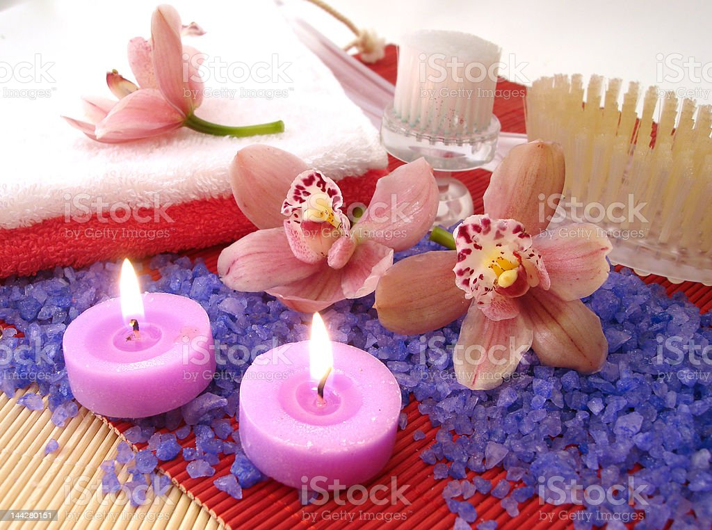 Spa essentials (salt, towels, candles, brushes and pink orchids) royalty-free stock photo