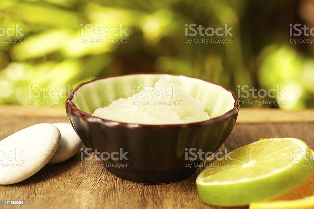 Spa exfoliation salt scrub lime slices and pebble stones royalty-free stock photo