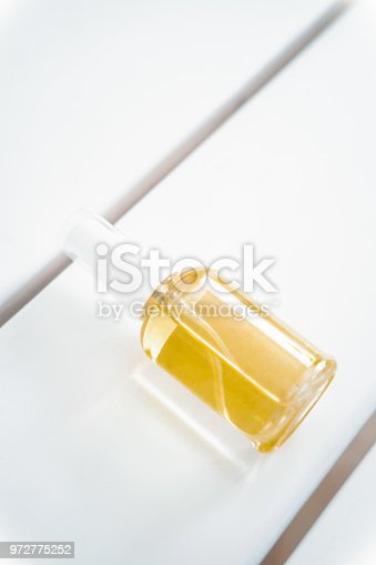 istock Spa face, hair, body oil bottle from above 972775252