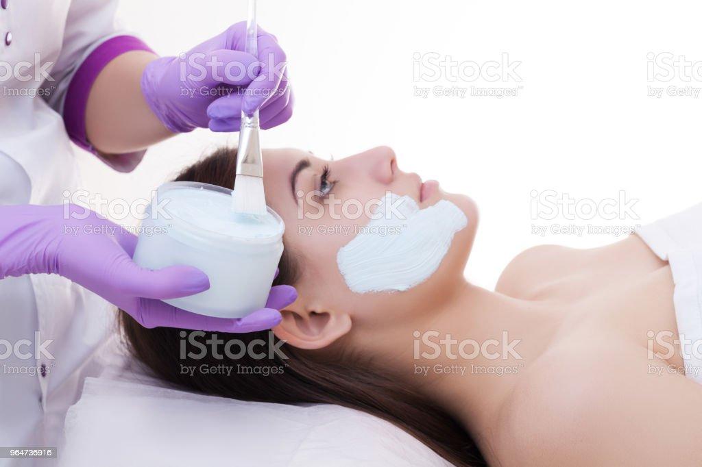 Spa facial mask application. Spa beauty organic facial mask application at day spa salon. royalty-free stock photo