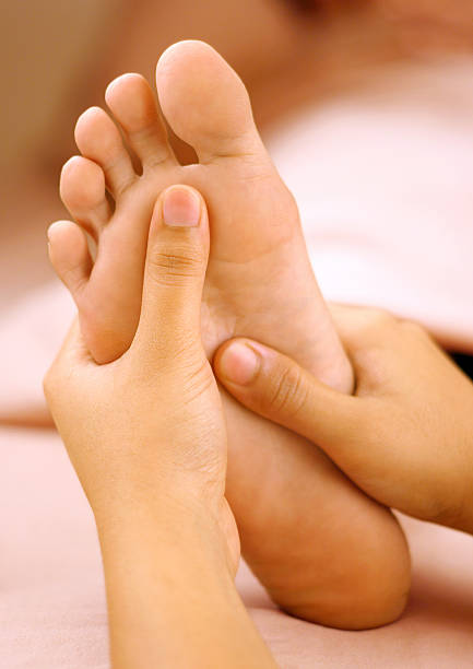 Spa foot massage  foot massage stock pictures, royalty-free photos & images