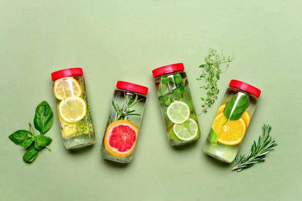 Spa fruits and herbs bottled infused water Fruits and culinary herbs bottled infused water, flat lay composition lemon fruit stock pictures, royalty-free photos & images