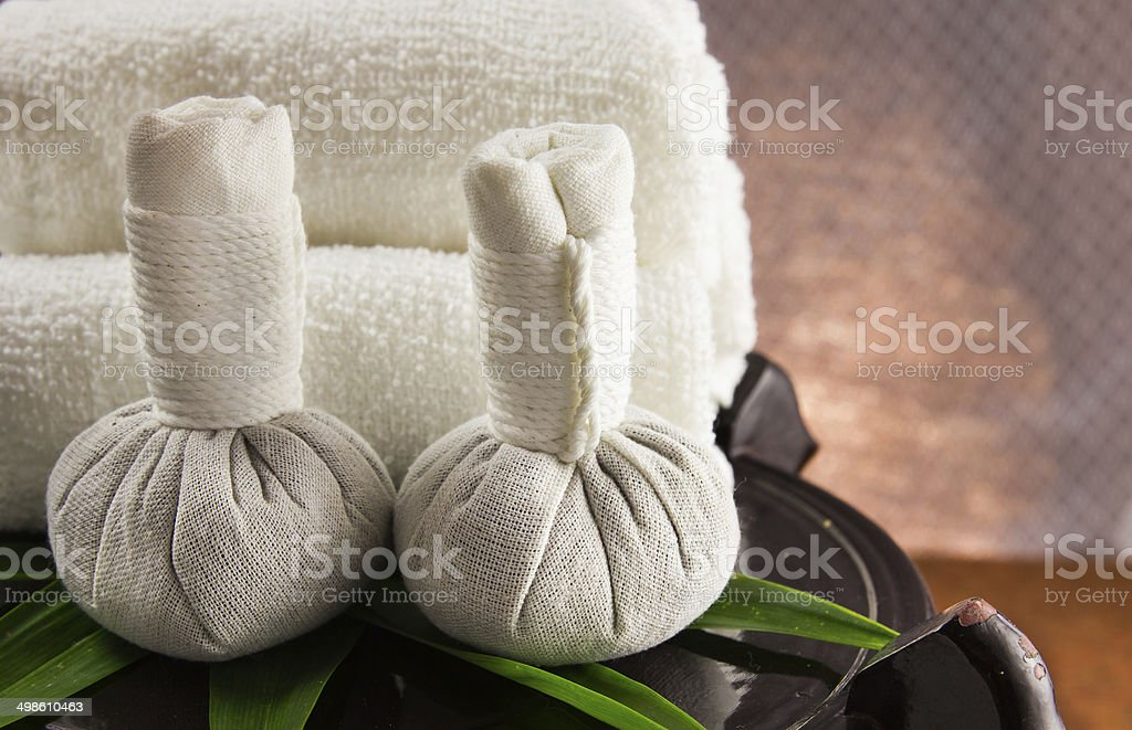 Spa herbal compressing ball with towels. stock photo