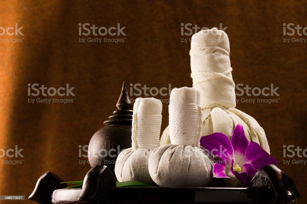 Spa herbal compressing ball with wooden casket and orchid royalty-free stock photo