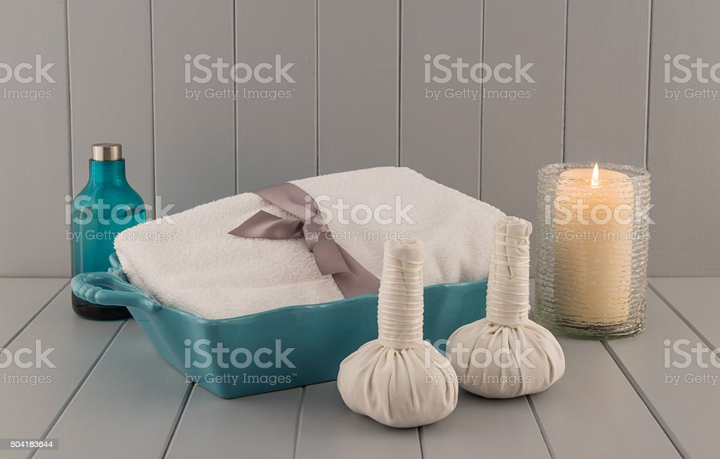 Spa Massage Balls with Massage Oil, Towel, and Candle stock photo