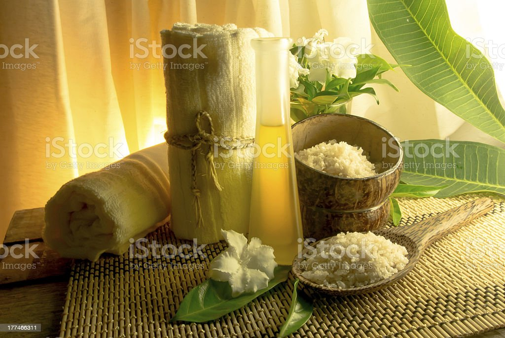 spa massage setting at sunset with candlelight royalty-free stock photo