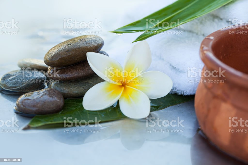 spa objects and stones for massage on white background