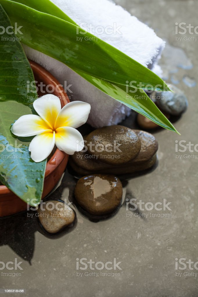 spa objects and stones, leaves and white towel for massage treatment...