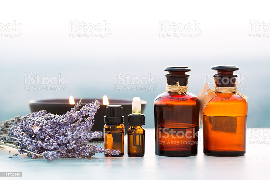 Spa oils in bottles with lavender stock photo