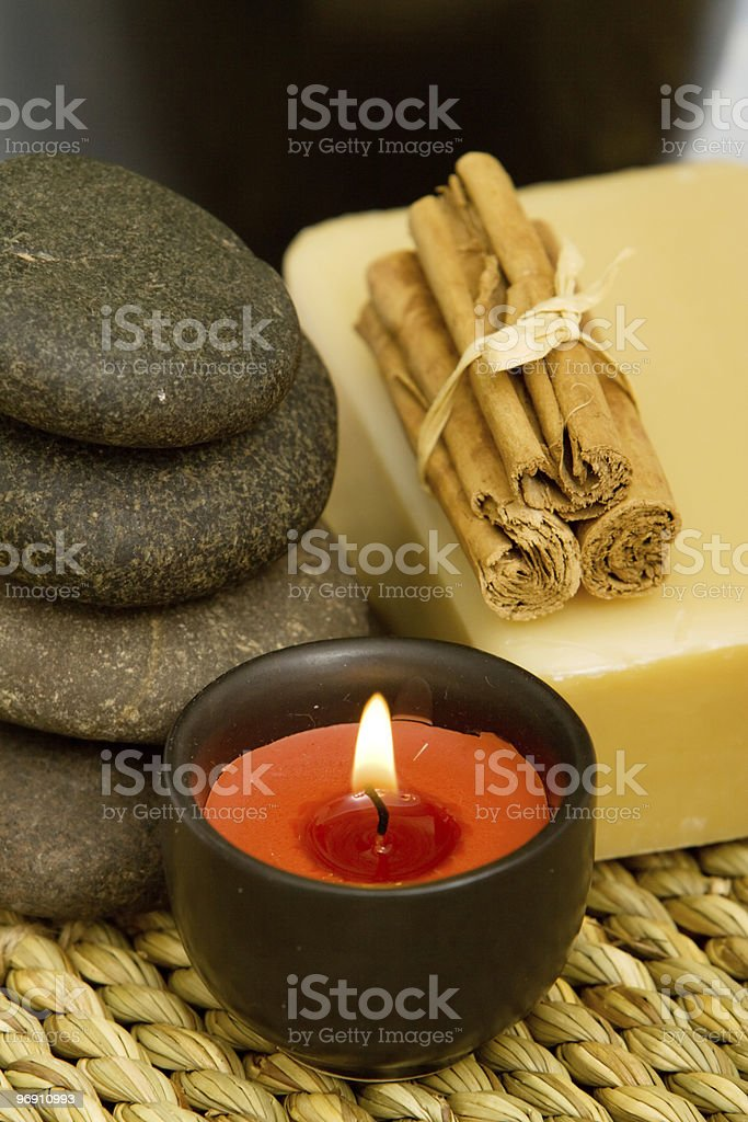 Spa or aromatherapy candle, stones and organic soap royalty-free stock photo
