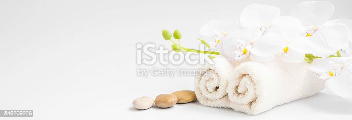 Spa white orchid flower with white cotton towels setting