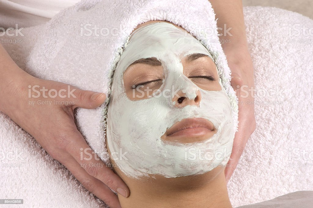 Spa Organic beauty facial mask hand on royalty-free stock photo