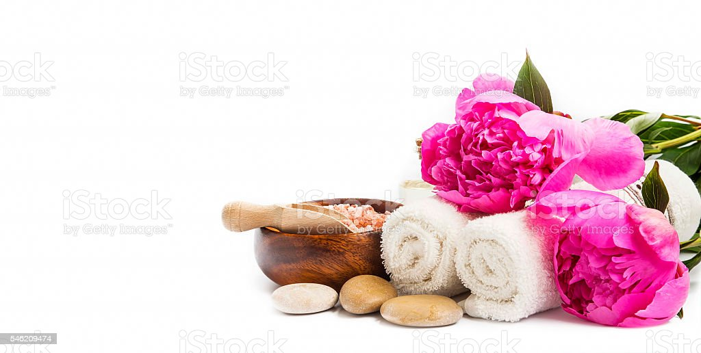 Spa peonies flowers with towels and stones - Photo