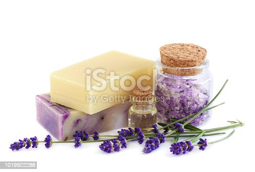 Lavender Spa products and lavender flowers on a white background. Handmade soap, essential oil and sea salt in glass bottles. Natural spa treatment