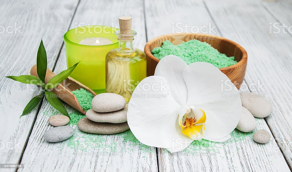 Spa products and white orchids stock photo