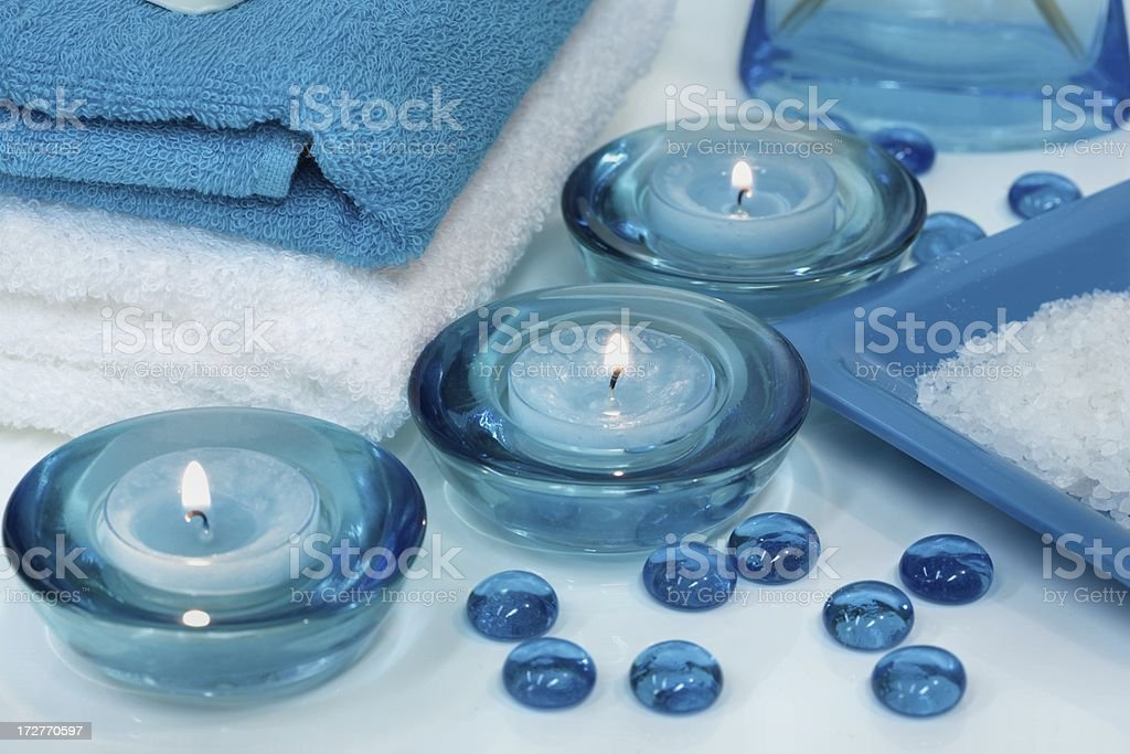 Spa Relaxation with white and turquoise candles, towels, salt royalty-free stock photo