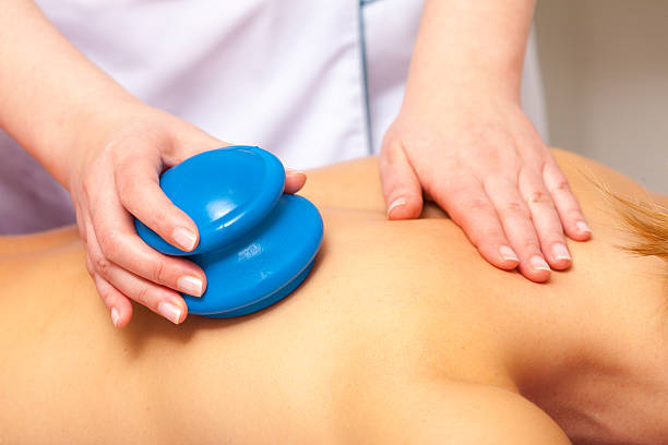 spa salon. woman relaxing having cupping-glass massage. bodycare. - cupping therapy stock photos and pictures