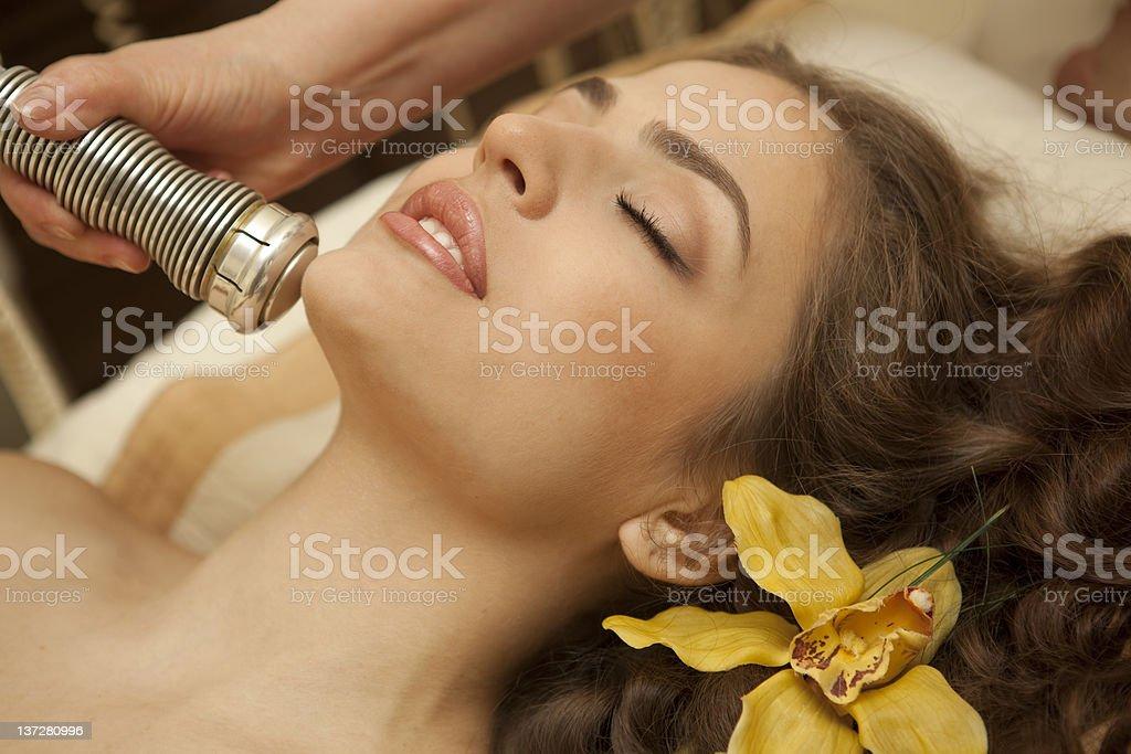 Spa salon: young beautiful woman having facial treatment. royalty-free stock photo